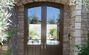 A custom double wood and glass entryway door
