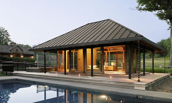 A pool house with multiple custom lift slide door systems by Veranda View