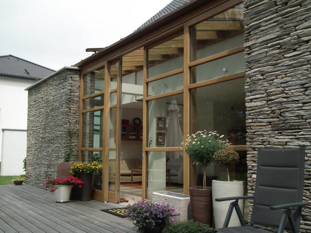 A modern wood lift slide door system by Veranda View