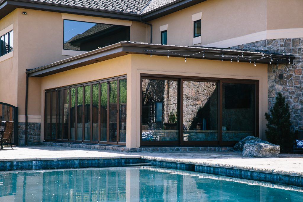 A folding door system and a lift slide door system combine to enclose a custom hot tub