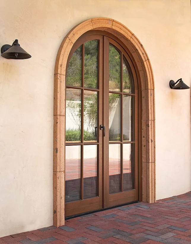 A tuscan style wood double entryway door with narrow profiles by Veranda View