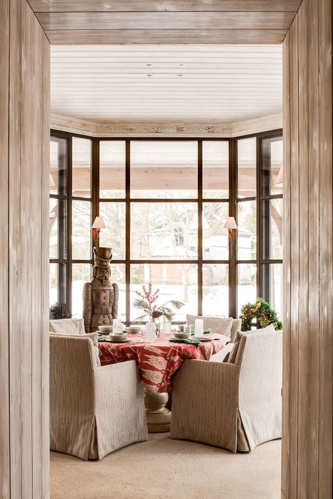 A dining room with accented by a thermally broken steel bay window