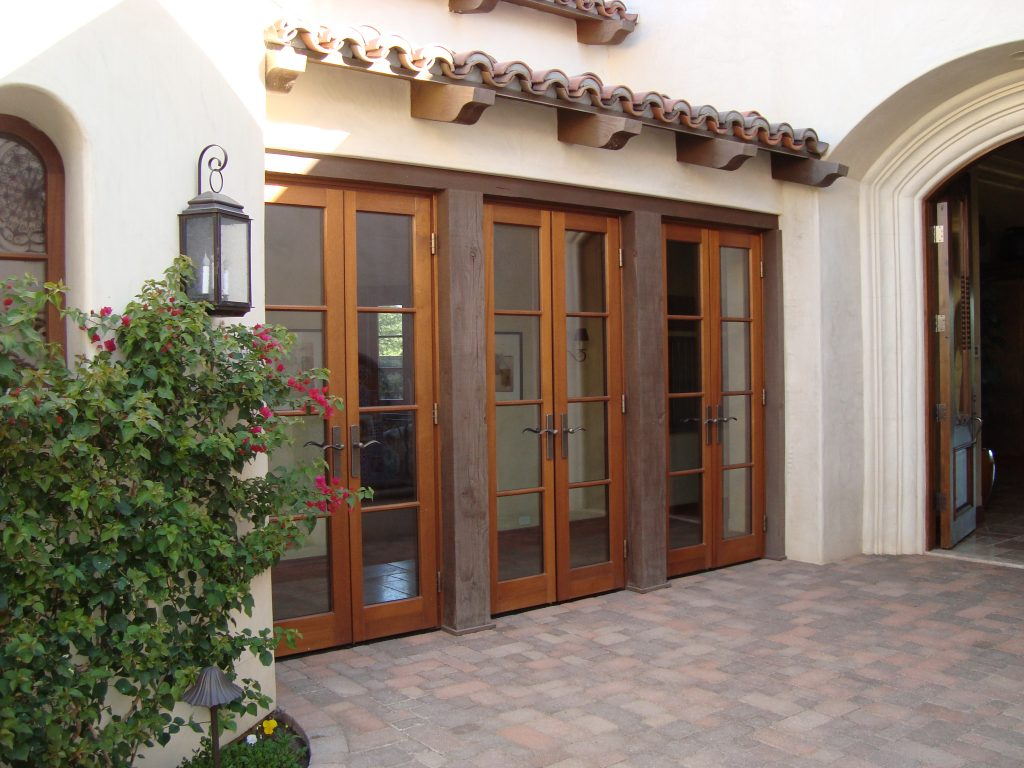 Three sets of outswing wood balcony doors by Veranda View