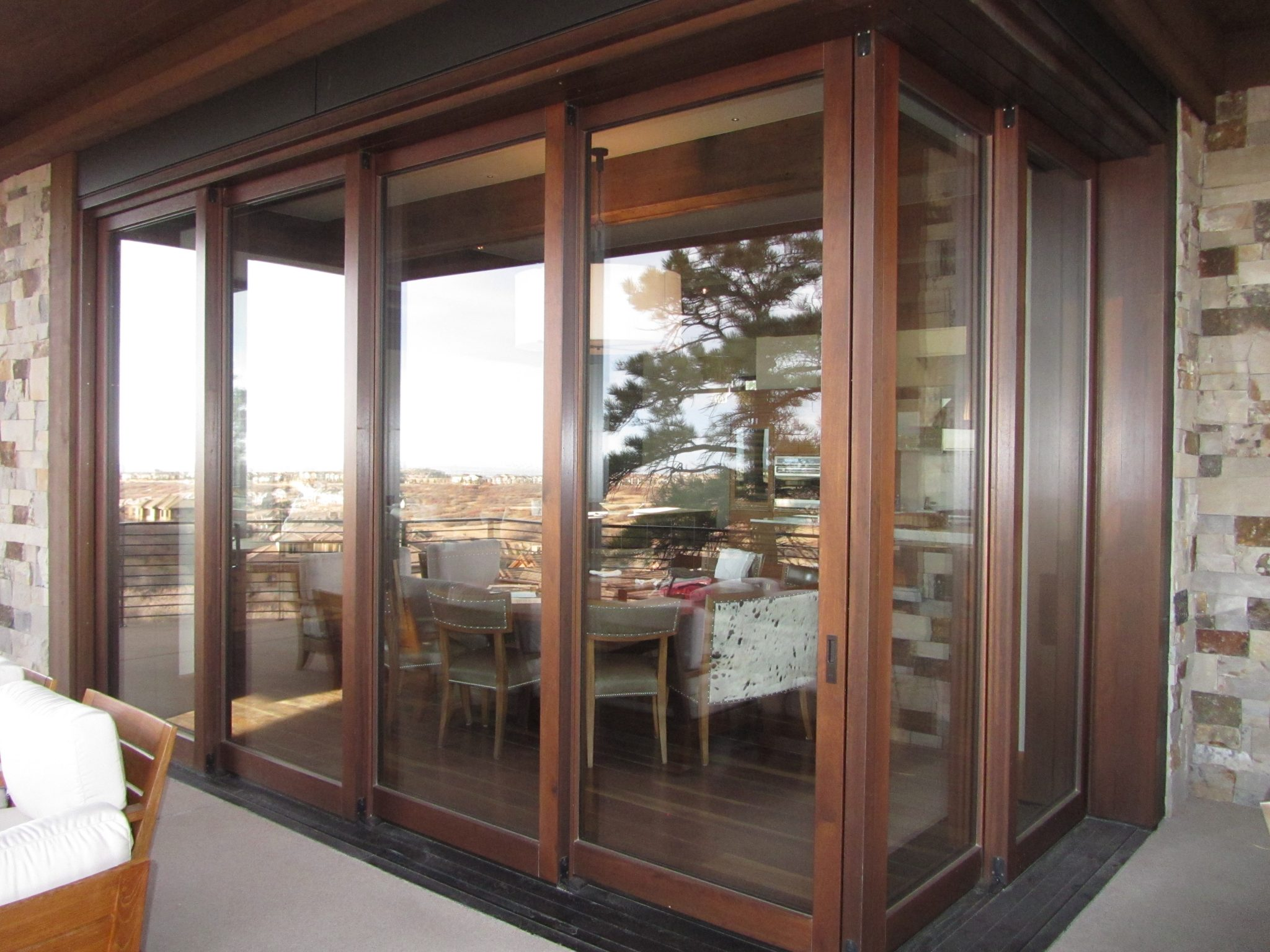 A custom corner meet wood lift-slide pocket door