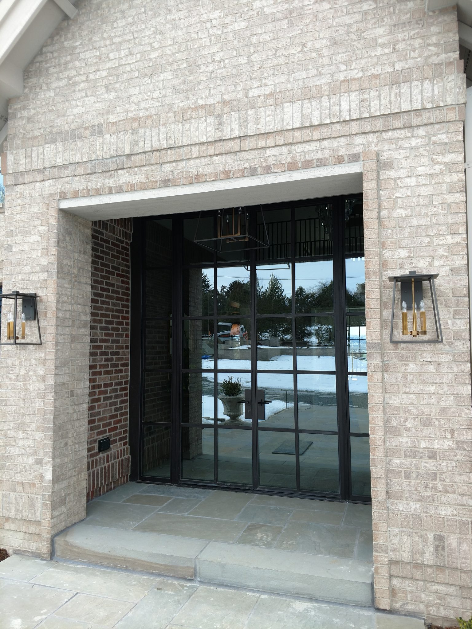 A double swing steel entryway door with side windows by Brombal