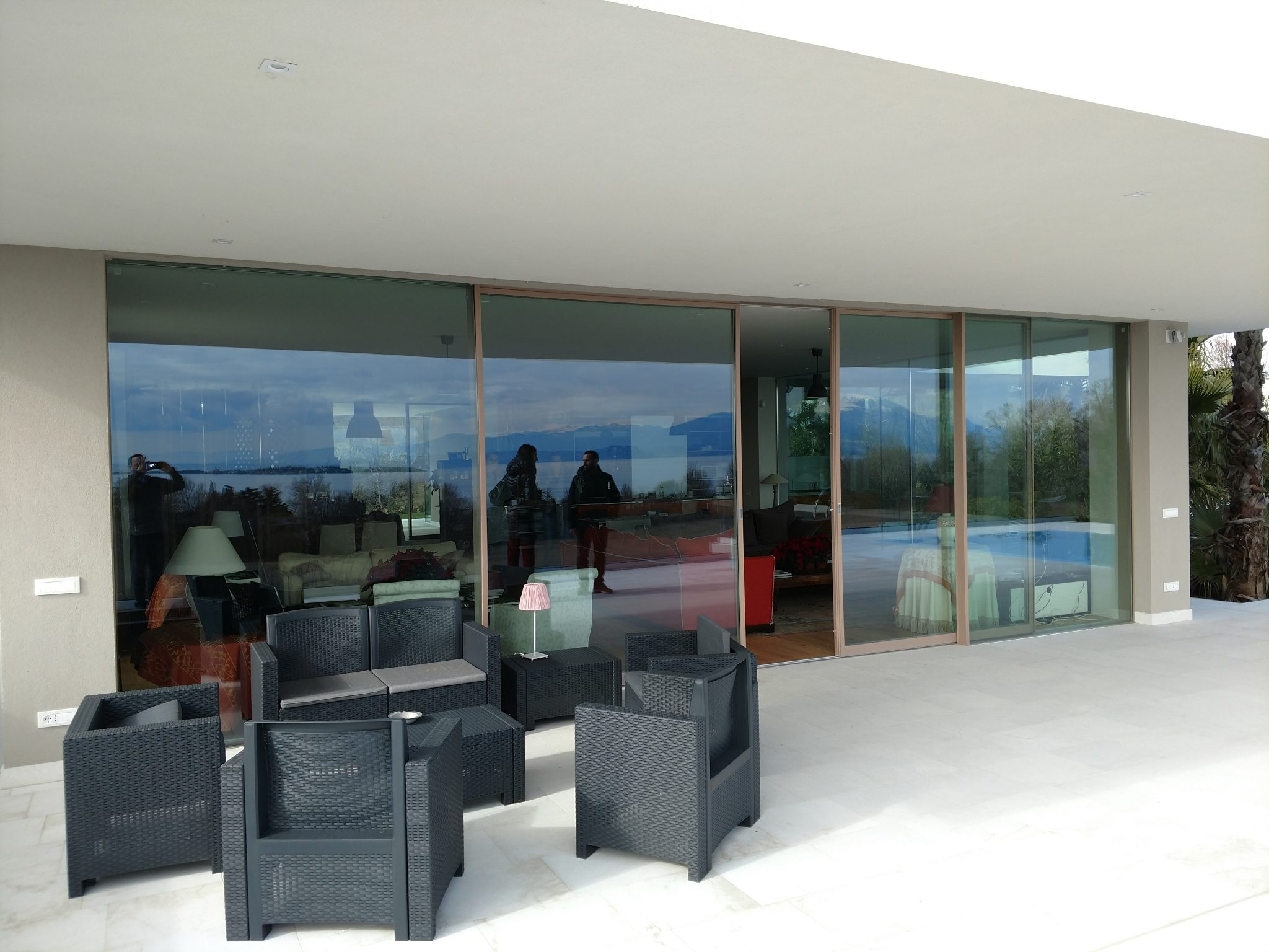 A Skyline wood minimal frame sliding door by Carminati Serramenti