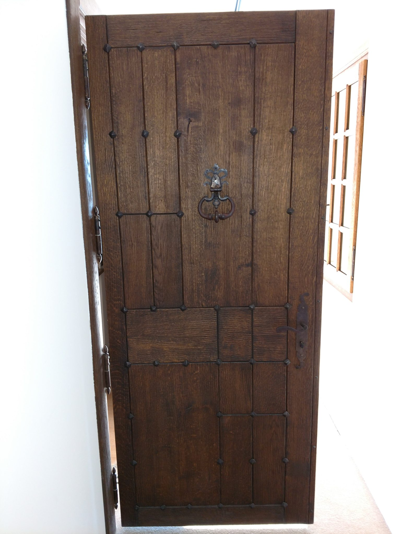 A custom wood with iron accents entryway door