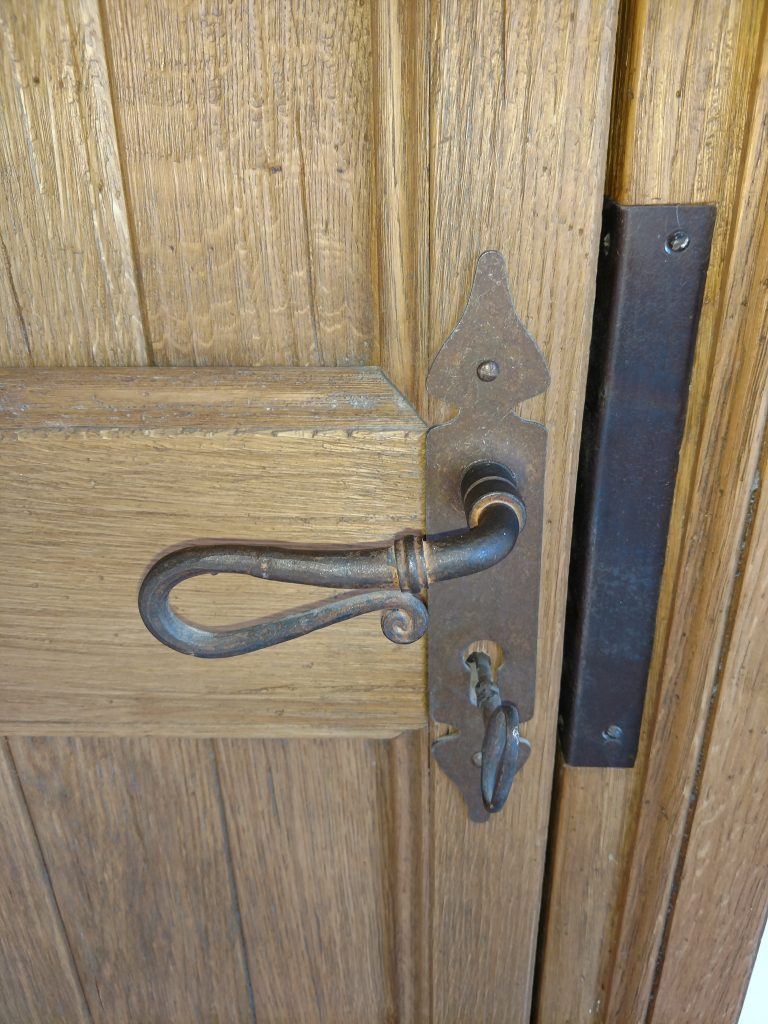 Detail of custom iron entryway hardware