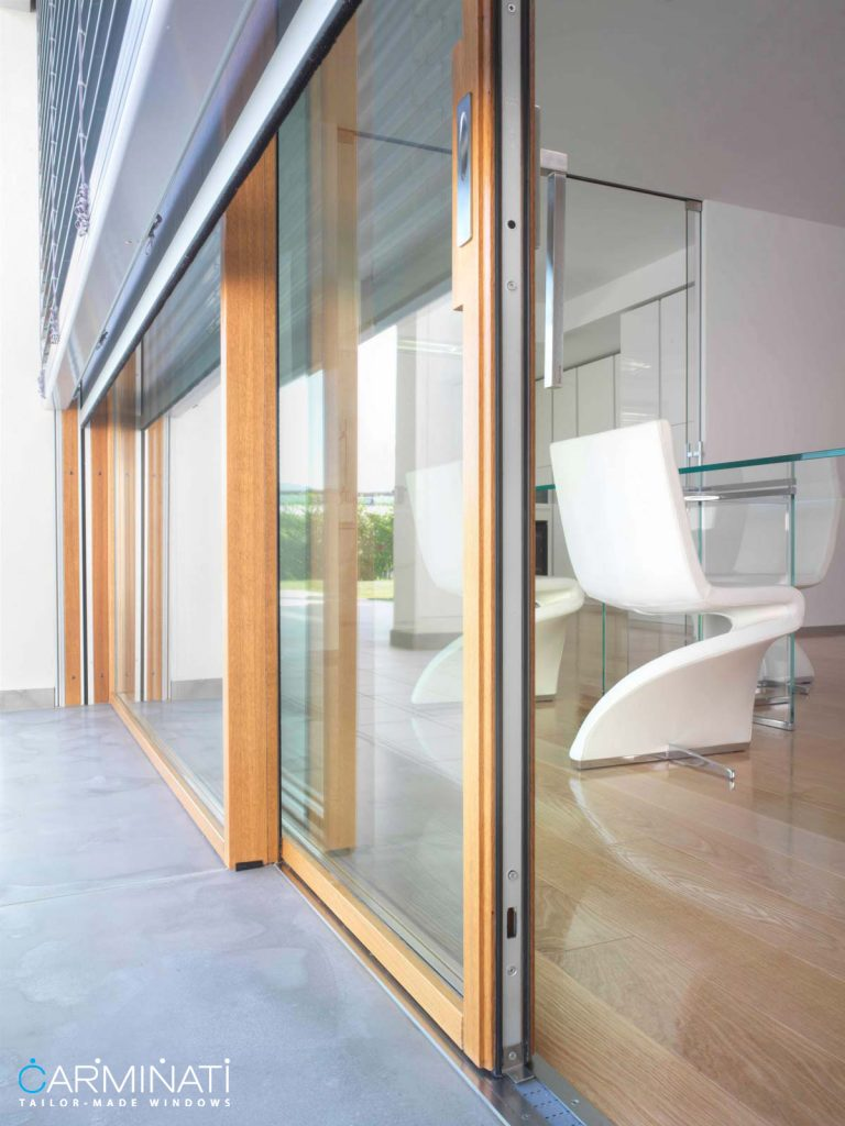 Carminati's Skyline minimal frame wood lift slide door system with embedded track