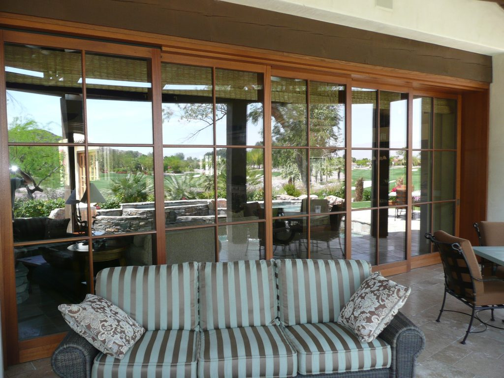 A wood lift slide pocket door system with narrow profiles by Veranda View