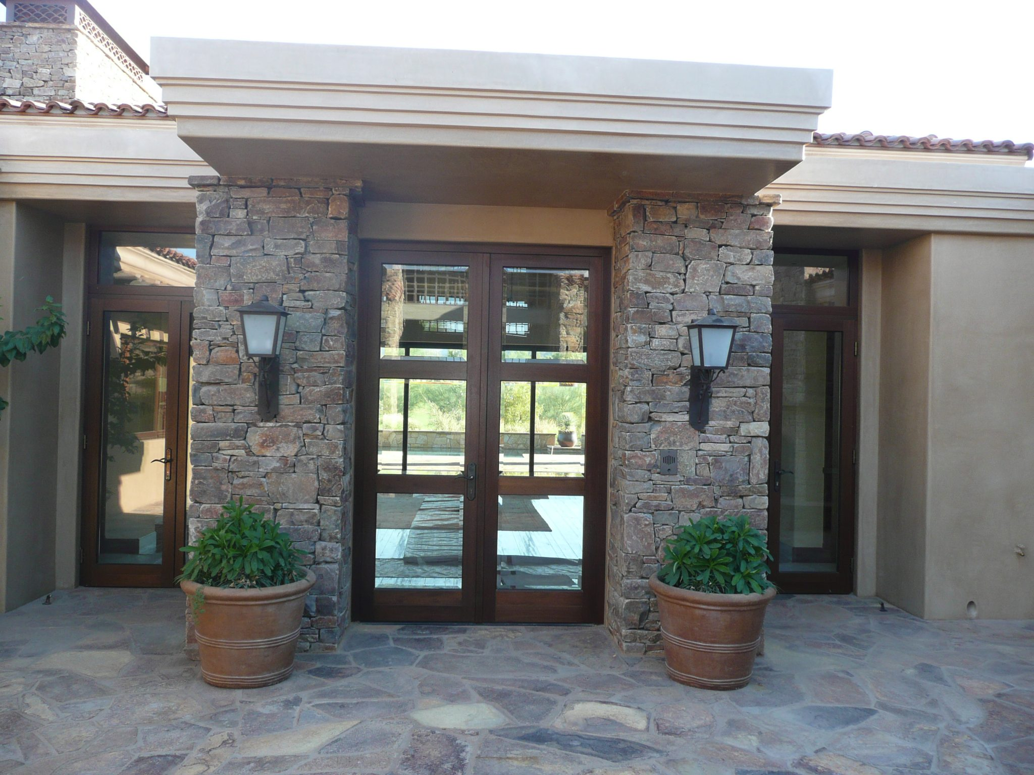 A contemporary double wood entryway door by Veranda View