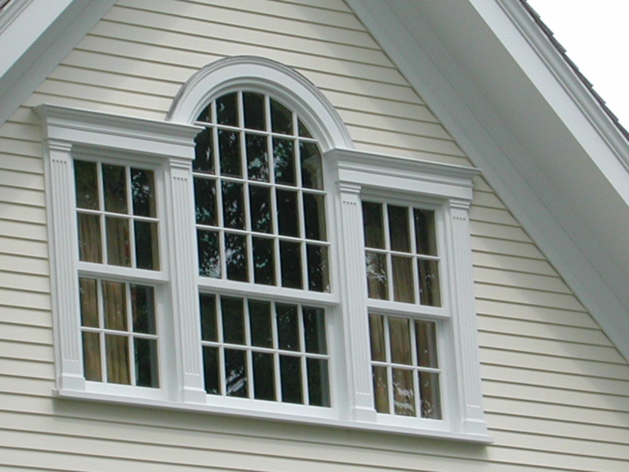 Window opening with three white double hung windows