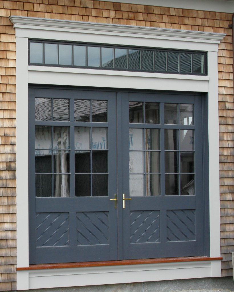Custom wood panel barn doors by Veranda View