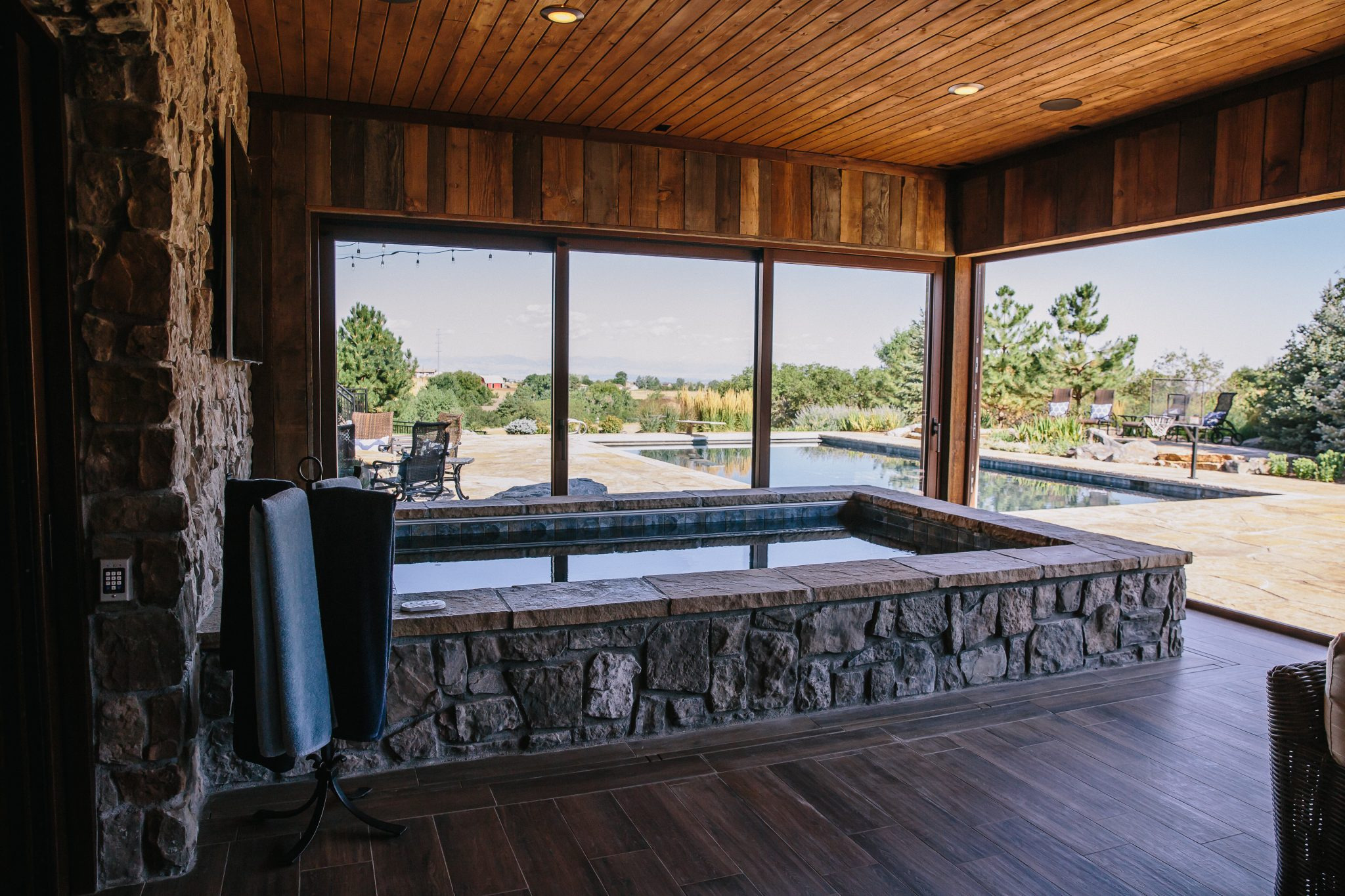 Two lift slide doors open the hot tub area to the patio and pool