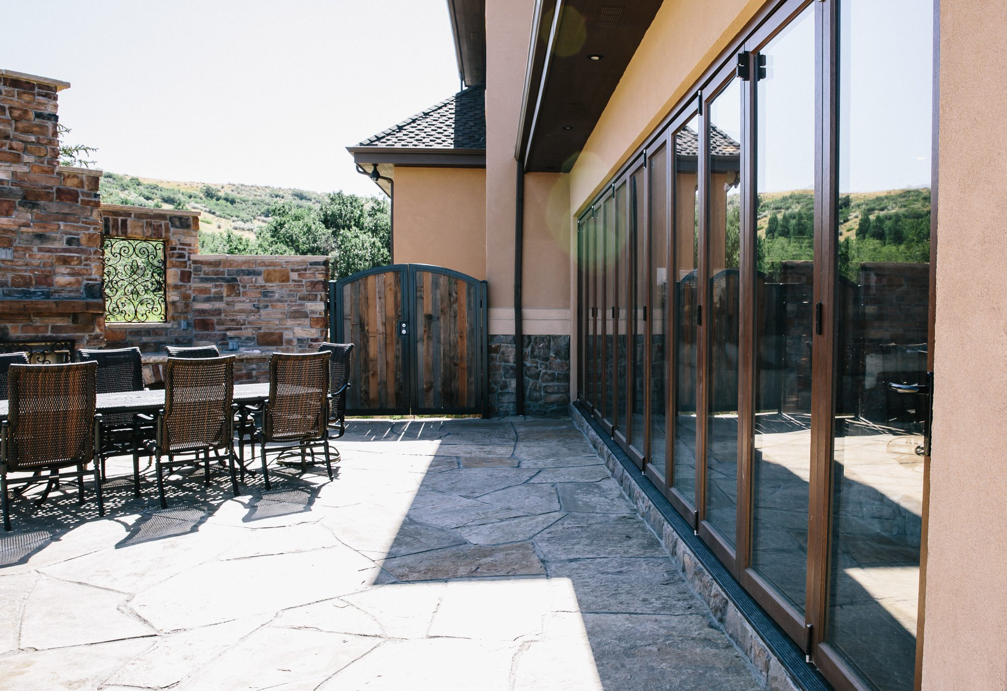 An expansive wood folding door system by Veranda View