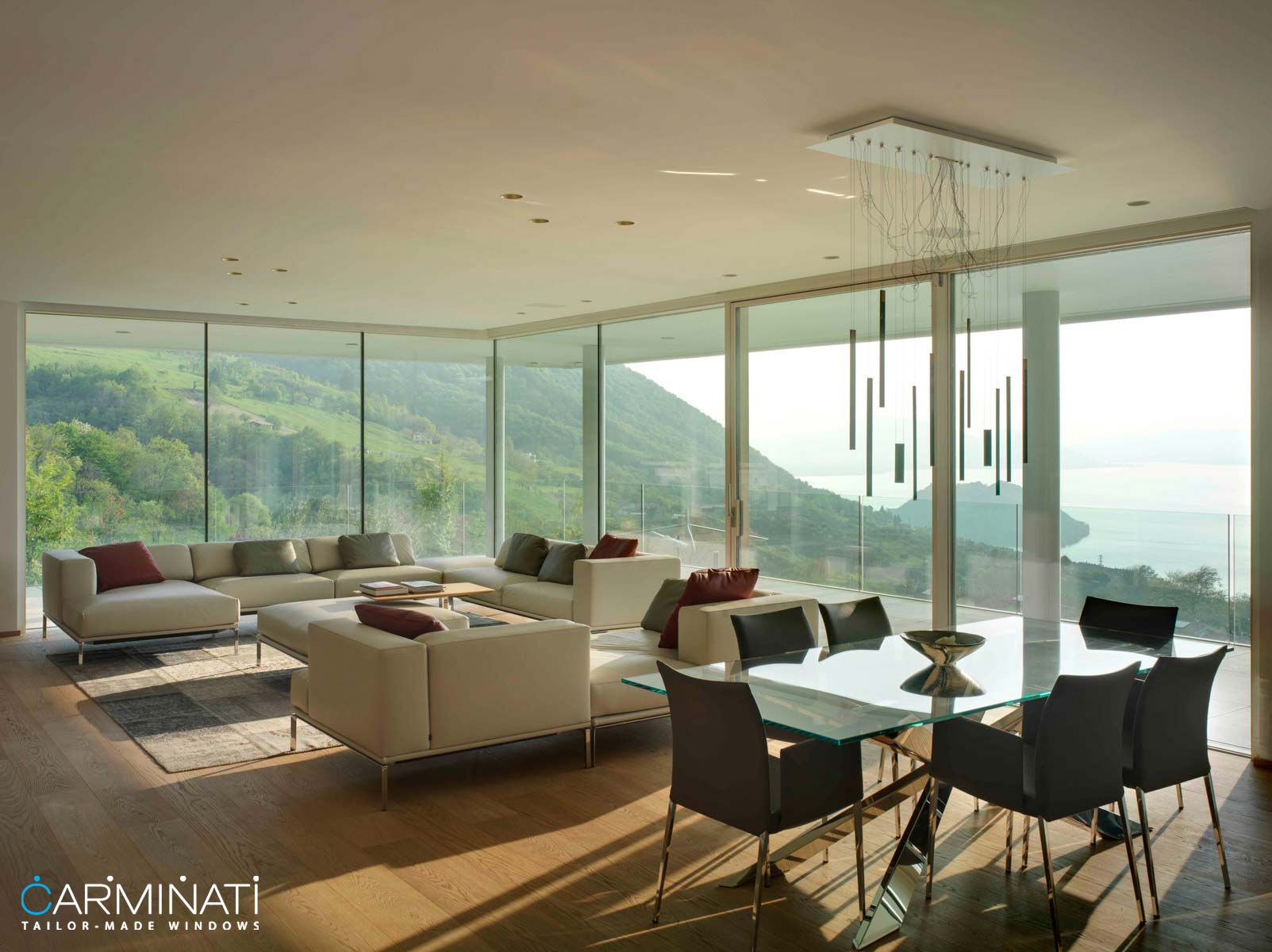 A villa is opened to the world through a minimal frame lift slide door system by Carminati