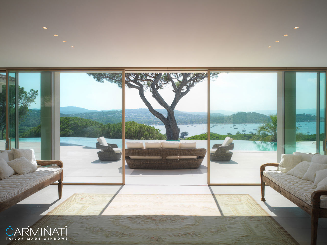 A minimal frame lift slide door system by Carminati opens this villa to the beautiful views of Saint Tropez
