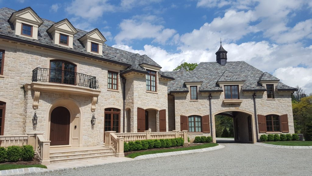 An estate enhanced with outswing wood windows and doors by Veranda View