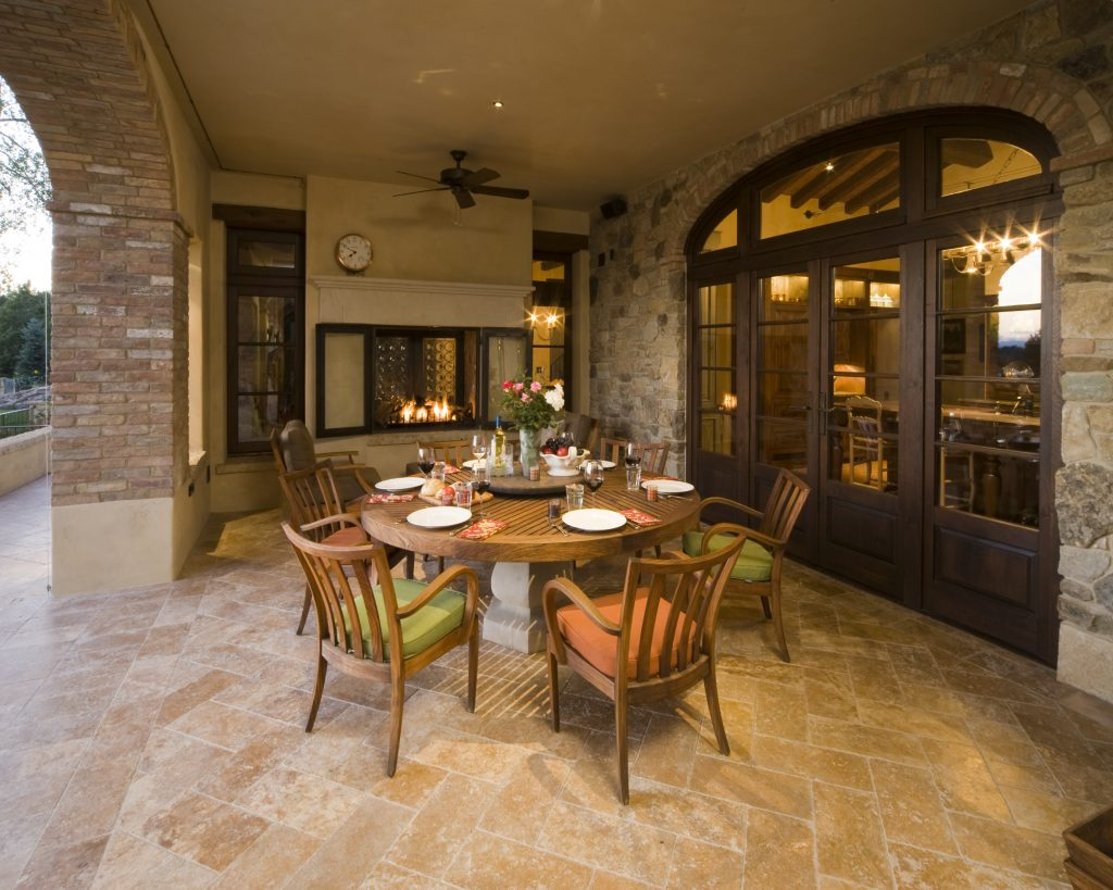 A patio with double European wood outswing doors and windows by Veranda View