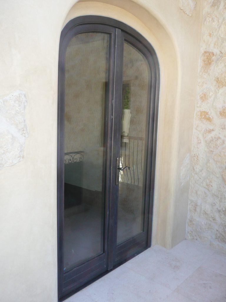 Double bronze outswing entryway door