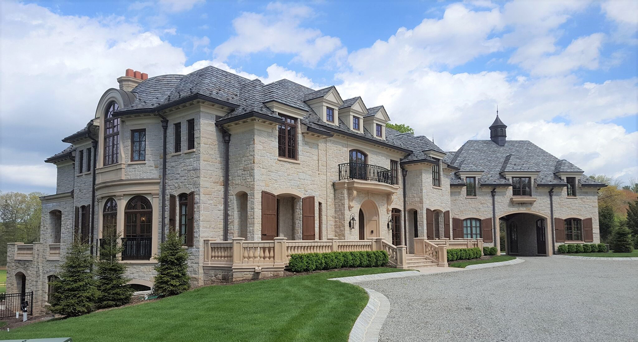 The grandeur of this estate is highlighted by custom wood windows and doors by Veranda View