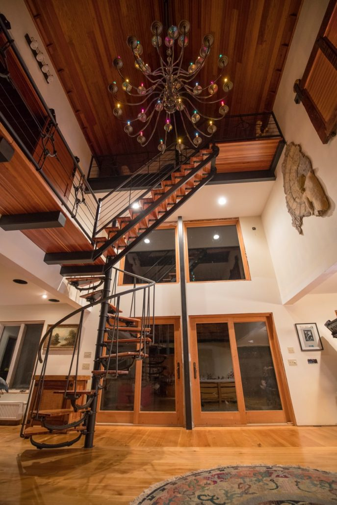 A three level steel and wood custom staircase by Vintage Steel