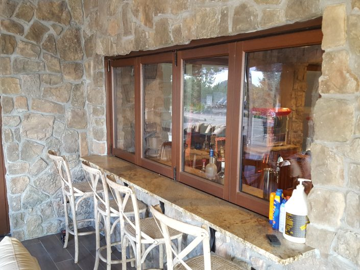 The patio bar features a four panel wood folding window