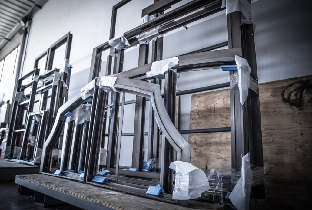 Steel window and door frames are securely stored while they wait for the next step