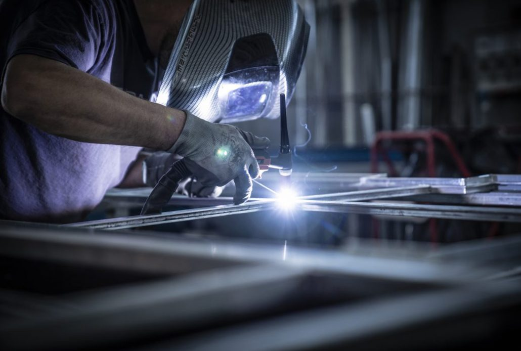 The welding of a Brombal steel window during manufacturing