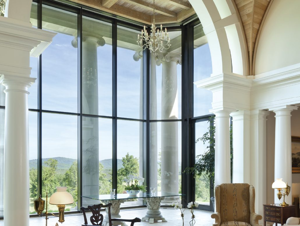 A thermally broken bronze curtain wall by Brombal opens up the back of this estate