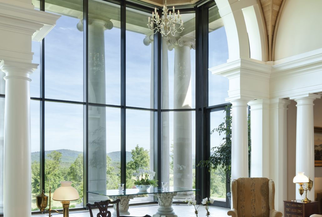 Stately home with a thermally broken steel curtain wall is flooded with natural light and unending views
