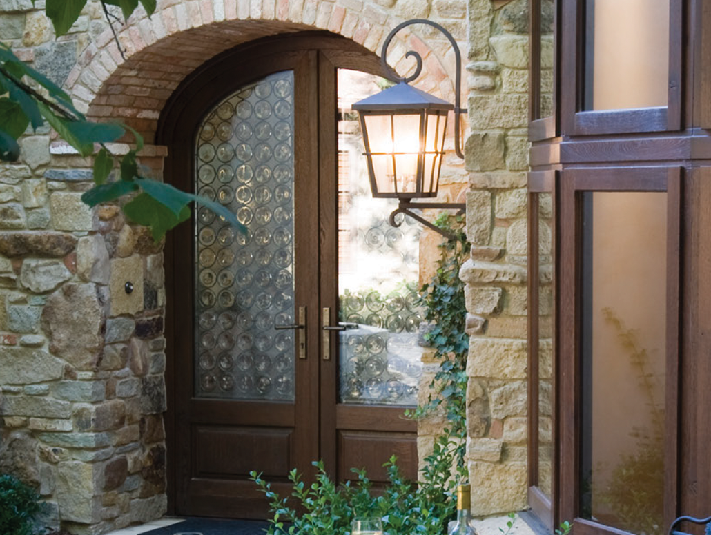 Custom European wood entryway door with decorative glass by Veranda View