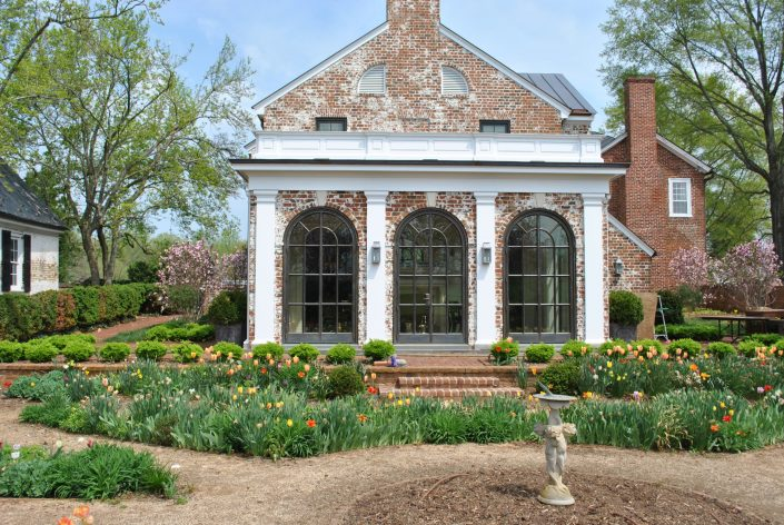 The arched bronze windows and doors bring old world charm to this estate