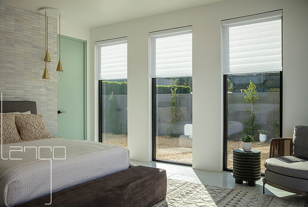 Natural light floods in this set of three fixed aluminum windows by SPI Finestre
