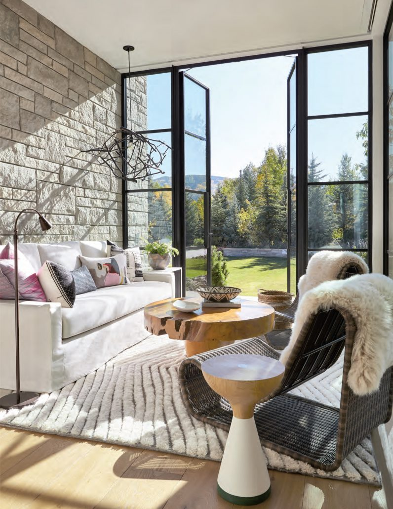 Thermally broken outswing steel doors open the sitting room to breath taking views of Aspen, Colorado