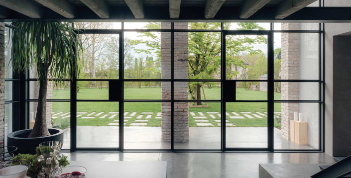 An entrance featuring two outswing minimal frame steel doors