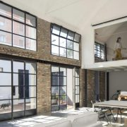 A loft accentuated by Vintage Steel's hot rolled steel doors