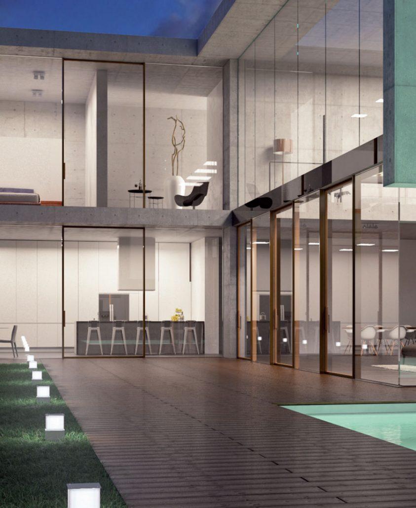 Carminati Serramenti's Skyline minimal frame windows and sliding doors in this modern villa create walls of glass
