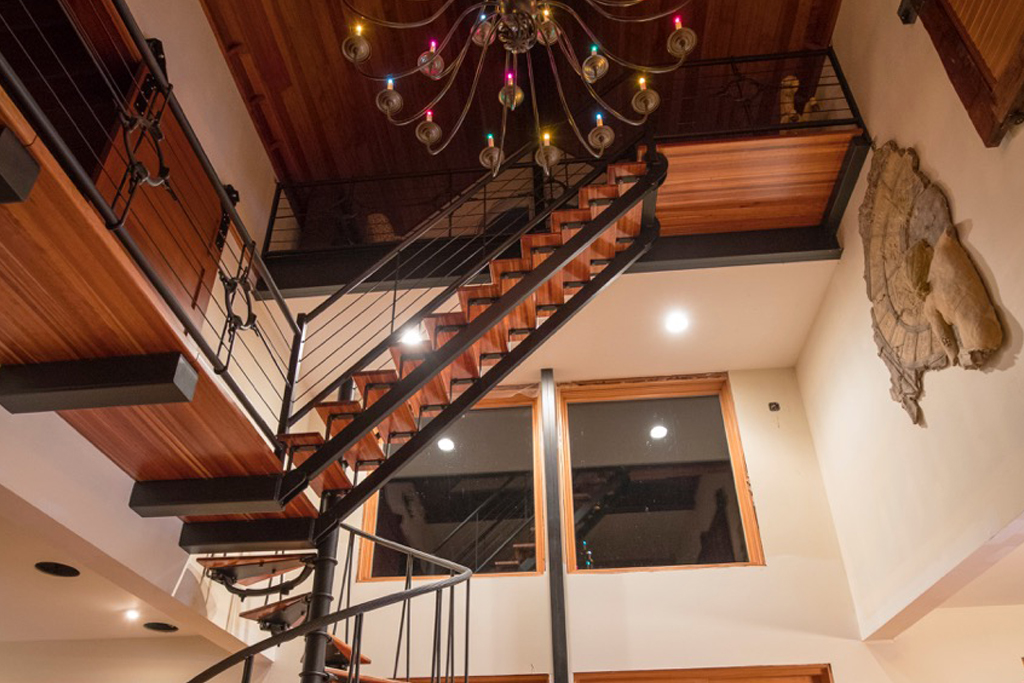 Multilevel staircase starts as circular stairs then converts to standard stairs going from the 2nd floor to the third floor