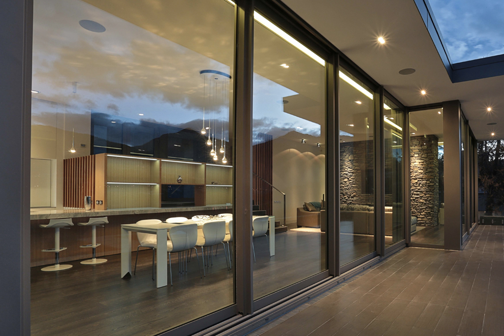 Expansive 6 panel custom aluminum lift slide door by SPI Finestre