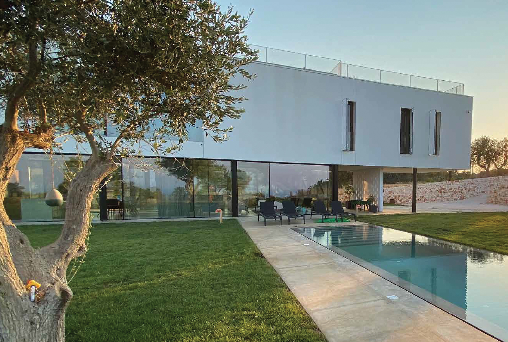 Minimal frame aluminum windows and door systems were used in this contemporary Italian villa for expansive views