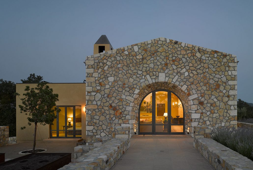 Bronze windows and doors by Brombal work in harmony with the stone and stucco exterior