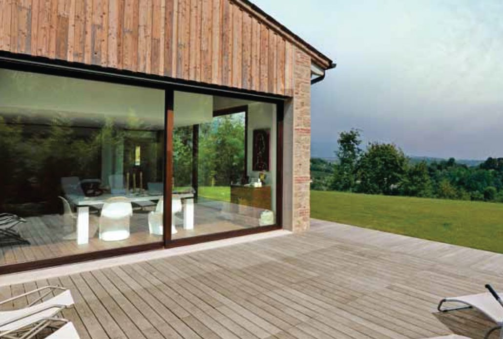 An oversized steel lift side door with a core-ten finish create a glass wall in which to enjoy the natural surroundings