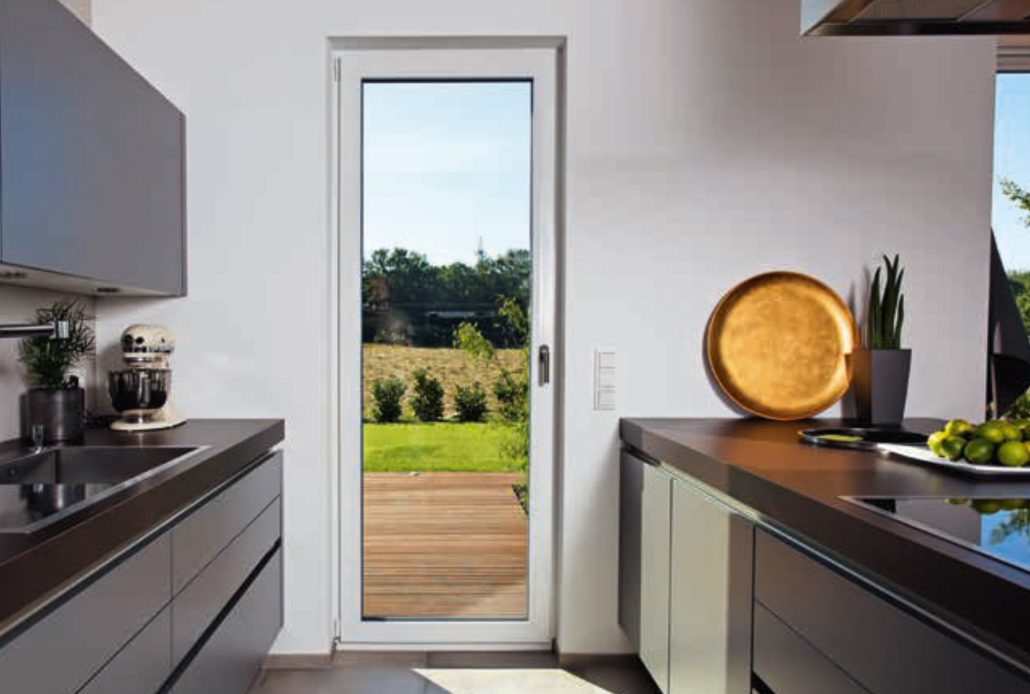 A single minimal frame PVC inswing door in the kitchen opens up to the deck outside