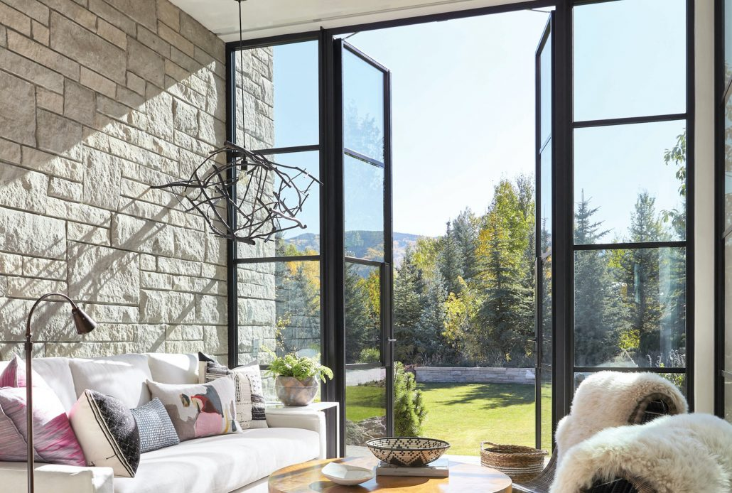 A double steel outswing door by Brombal brings the cool Aspen air into the sitting area