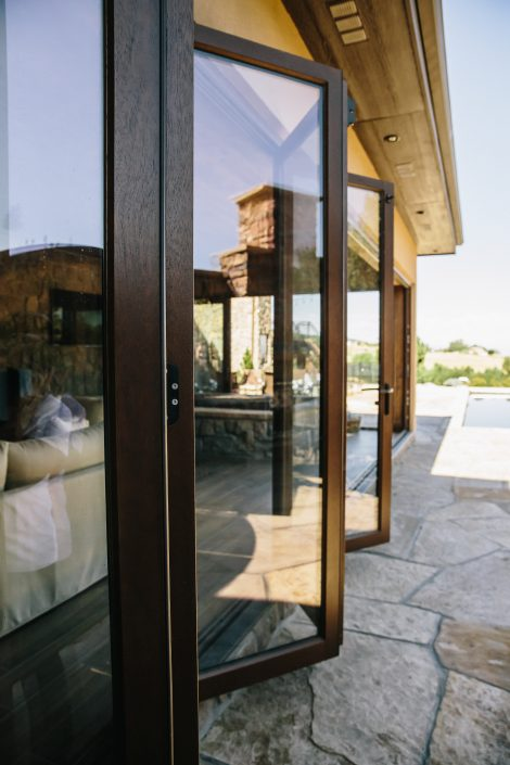 An eleven panel wood folding door system expands the lower level living area to the outdoors