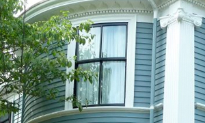 A curved double hung window is painted black for a contemporary look.