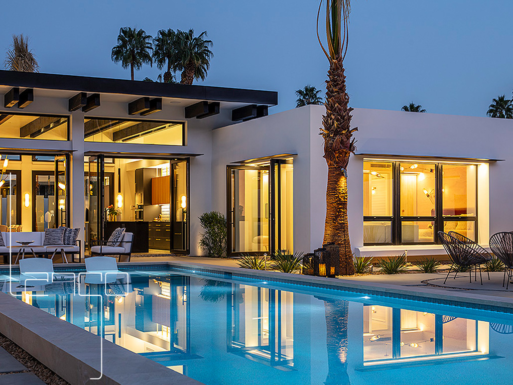 Black aluminum window and door systems by SPI Finestre open out to the outdoor lounge and pool area