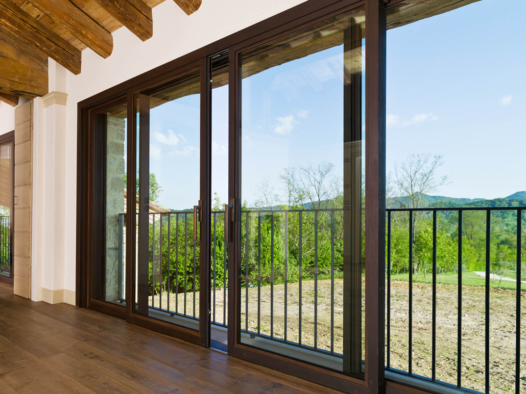 An oversized cor-ten lift slide door with expansive glass allows for unobstructed views