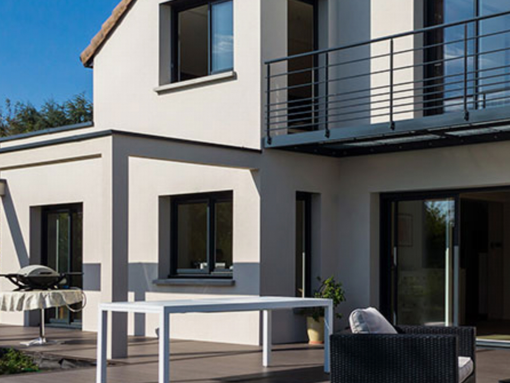 Windows and doors finished in black were installed in this European villa. Materials: PVC